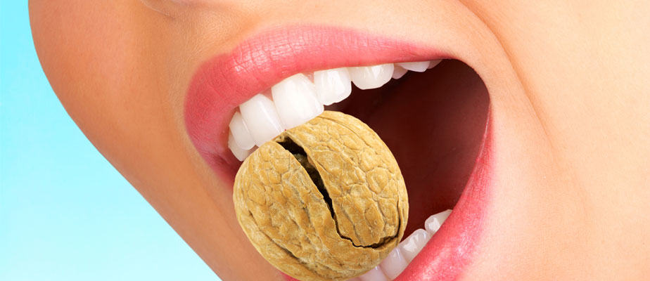 Picture of teeth biting into hard nut shell